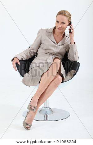 Smart executive woman using a telephone
