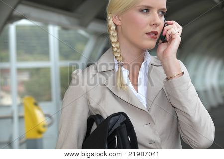 woman on a business travel talking on her cell phone