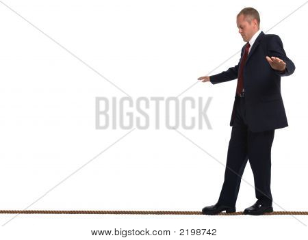 Businessman Walking A Tightrope