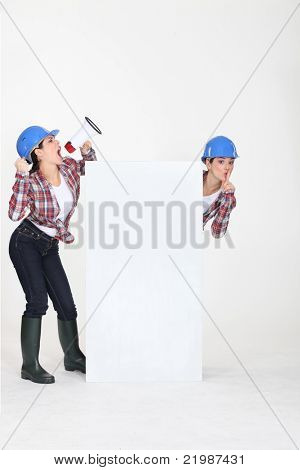 twin sisters with hard hat and loudspeaker
