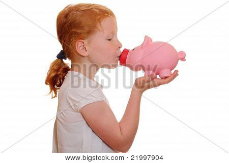 Girl Kisses A Piggy Bank