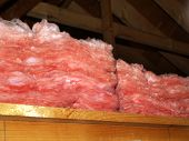 foto of insulator  - Pink fiberglass insulation in the construction in the attic - JPG
