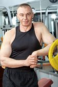 picture of mature men  - Mature sporty man in the gym centre - JPG