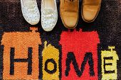 Welcome Home Carpet With Shoes On It. poster