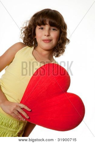 Little girl holding a big red heart for mother's day