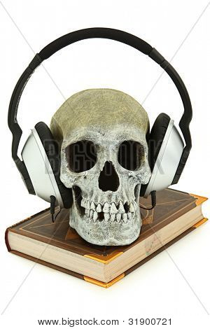 Audiobook concept with human skeleton wearing audio headset sitting on book.