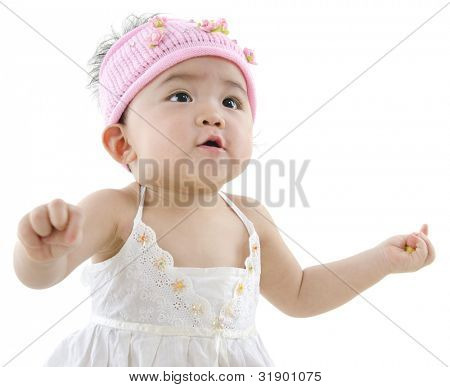 Happy 10 month old pan asian baby girl in pink flower hat