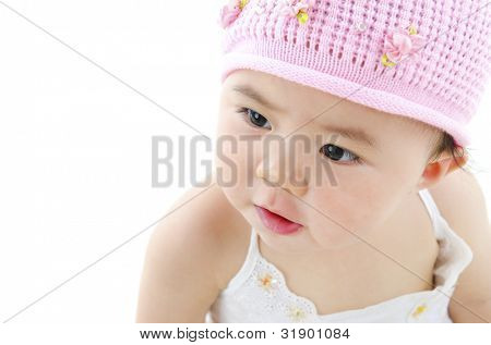 Adorable pan asian baby girl on white background