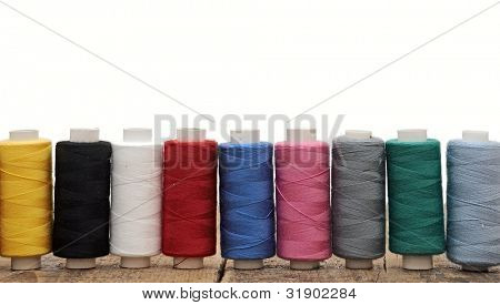 colorful threads for embroidery on a white background