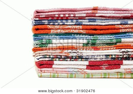 Pile of linen kitchen towels on a white background. space for your text
