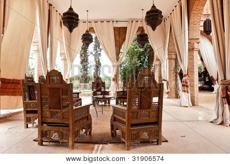 Interior view of an arabian Riad Tent with traditional furniture, carpet, Marrakech, Morocco, North Africa.