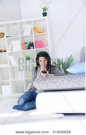 Young woman choosing music over the smart phone