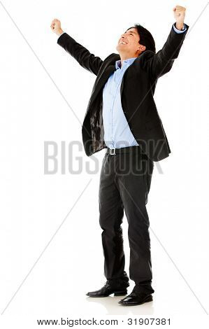Successful business man with arms up - isolated over a white background