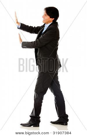 Business man pushing something with his hands - isolated over a white background