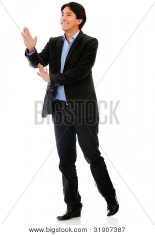 Businessman pushing with his hands - isolated over a white background