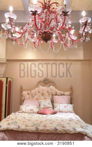 Bedroom With Red Chandelier