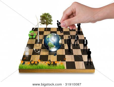 Hand Playing chess game with Silhouettes of business people vs nature (tree,earth,Wind turbines,flower,bulb) (Elements of this image furnished by NASA)