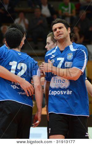 KAPOSVAR, HUNGARY - MARCH 17: Andras Geiger (7) in action at a Hungarian Championship volleyball game Kaposvar (blue) vs. Kazincbarcika (white), March 17, 2012 in Kaposvar, Hungary.