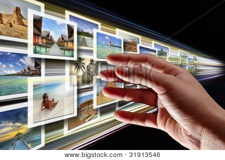 Hand reaching streaming multimedia from internet. All images coming from my gallery.