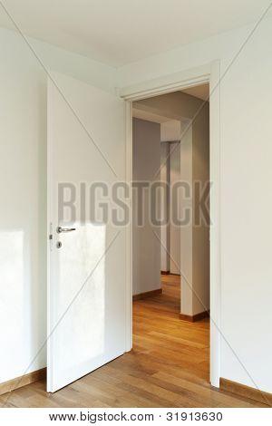 interior empty room, white walls, open door