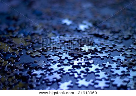 blue puzzle pieces very shallow depth of field, good background image or concept (confusion, indecision)
