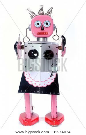 vintage toy robot walking toward you on a white background