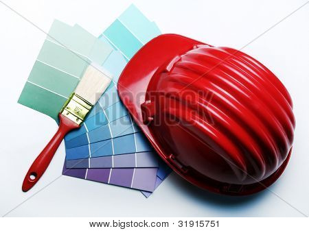 Color pallete with brushes and hard hat