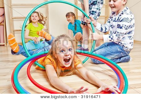 Emotional kids having fun in gym