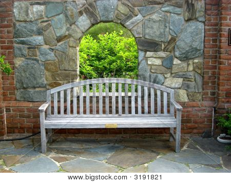 Private Bench With Window View Into Garden