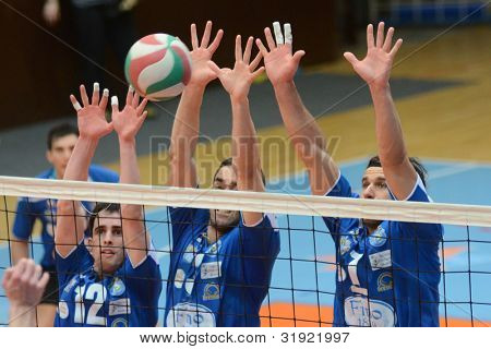 KAPOSVAR, HUNGARY - MARCH 17: Alpar Szabo (blue 1) in action at a Hungarian Championship volleyball game Kaposvar (blue) vs. Kazincbarcika (white), March 17, 2012 in Kaposvar, Hungary.
