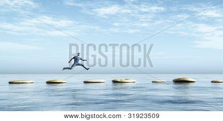 Una imagen de un hombre que salta de piedra en piedra