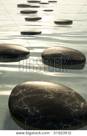 An image of some nice black step stones in the sea