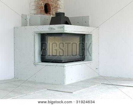 Modern corner wood-fired fireplace under construction