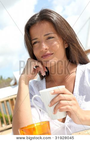 Portrait of beautiful young woman having breakfast