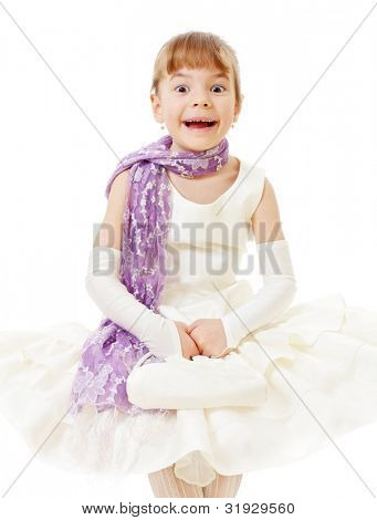 Surprised funny little girl in cream dress, purple scarf and little bag in her hands. Isolated on white background, mask included