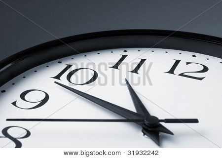 White clock face with black border on gray background