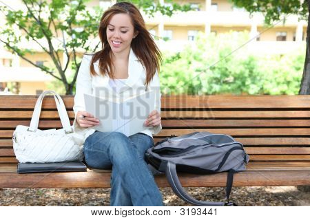 Cute Girl Reading At School