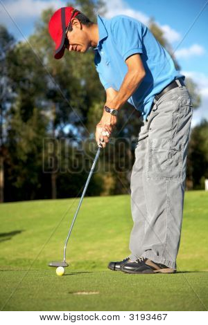 Male Golfer In Putting Green
