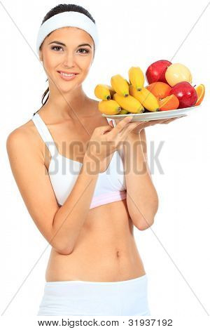 Portrait of a beautiful young woman with fruits. Isolated over white background.