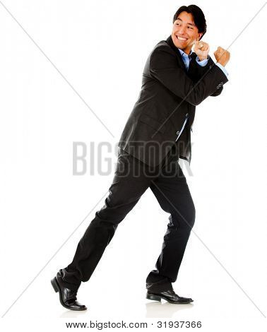Business man pulling an imaginary rope - isolated over a white background