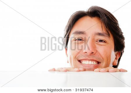 Man looking over a table - isolated over a white background
