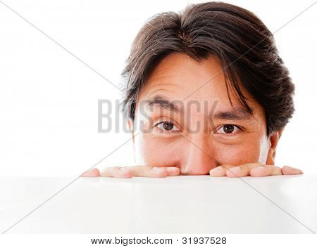 Man peeking over a table - isolated over a white background