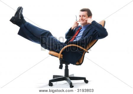 Young Businessman Relaxed In Chair.