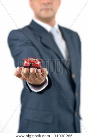 Businessman Presents A Toy Car