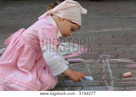 Small Girl Drawing With Chalk