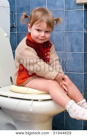 Child On The Toilet