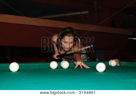 A Woman Playing Billiard