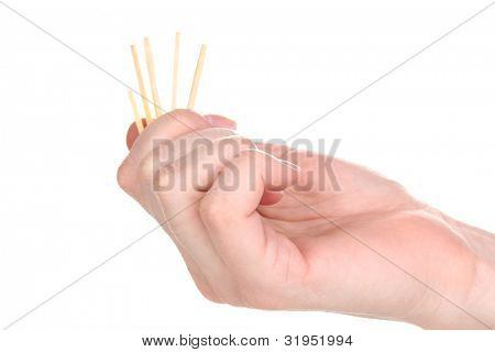 Matches in hand isolated on white