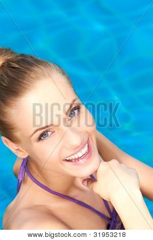 Close up of happy girl she standing in swimming pool