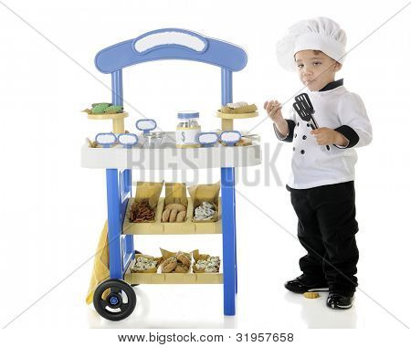 "A preschool ""chef"" becoming stupified from snitching goodies from his vendor stand.  The stand's signs left blank for your text.  On a white background."